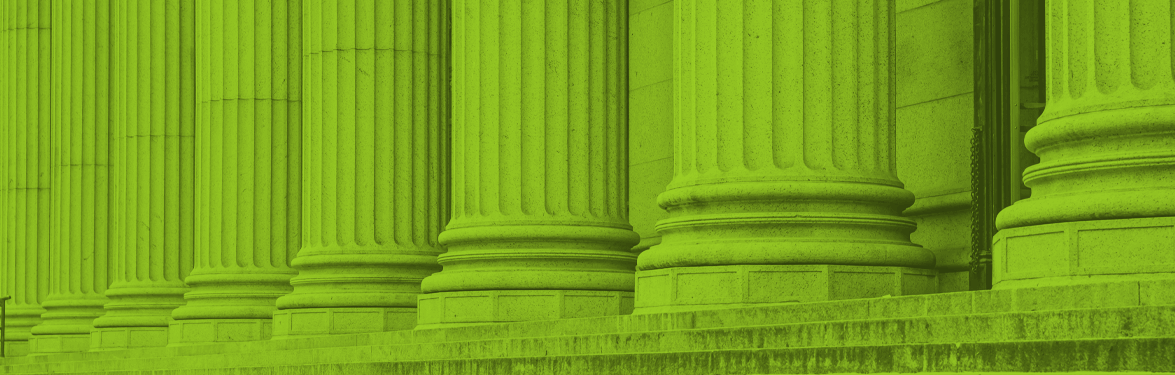 government building columns green banner